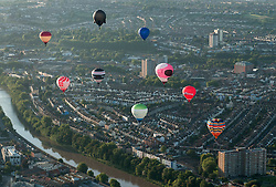 © Licensed to London News Pictures. 31/07/2015. Bristol, UK.  Hot air balloons are launched from the Lloyds Amphitheatre in Bristol Harbourside as a preview for the Bristol International Balloon Fiesta next week which runs from 06-09 August.  Photo credit : Simon Chapman/LNP
