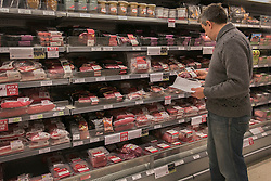 © licensed to London News Pictures. London, UK 13/02/2013. People shopping in a Waitrose branch in London after frozen packs of 16 beef meatballs from Essentials range removed from sale. Meatballs labelled as being made from beef contained pork. Photo credit: Tolga Akmen/LNP