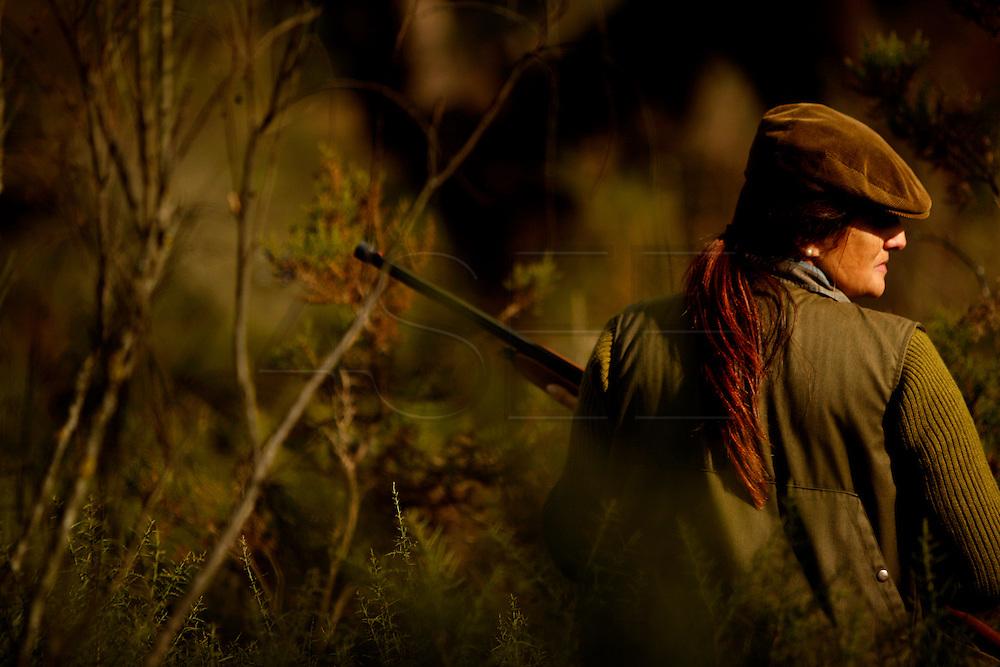 PMM#281109_The Chase_ Chancelaria Velha, Alter do Chão, Alentejo, Portugal. A Woman hunter chasing partridges.