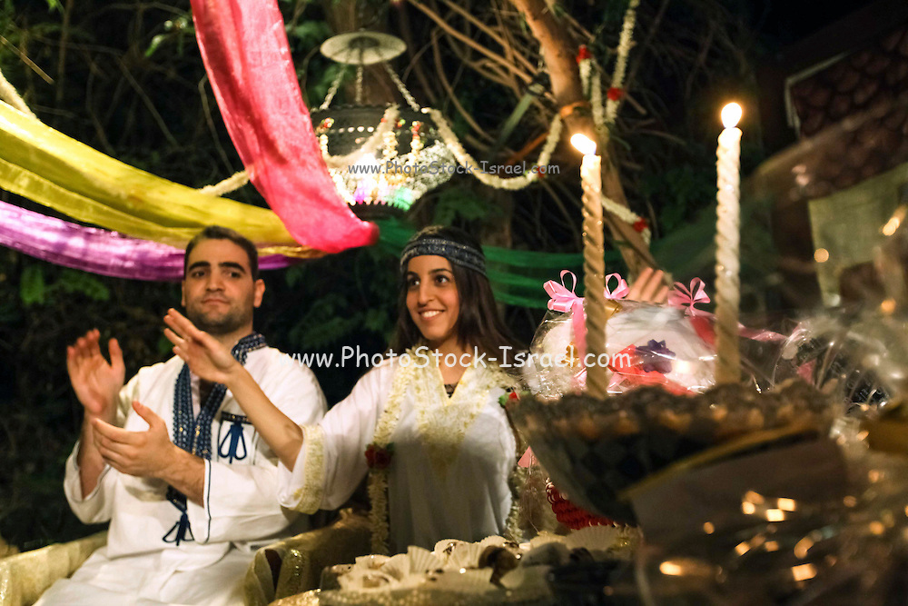 Groom and bride to be at their Mehndi (henna) ceremony, a traditional celebration befor the marriage ceremony