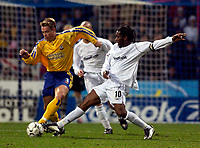 Photo. Jed Wee.<br /> Bolton Wanderers v Southampton, FA Barclaycard Premiership, Reebok Stadium, Bolton. 08/11/03.<br /> Southampton's Graeme Le Saux (L) is tackled by Bolton's Jay Jay Okocha.