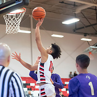 Isaiah Johnson (15) of Grants scores on the layup against Kirtland Central at the Eddie Pena Classic in Grants on Friday. Grants won 60-42.