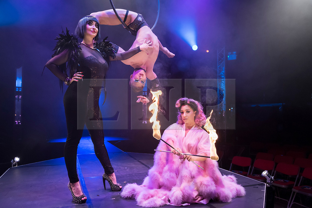 """© Licensed to London News Pictures. 24/04/2019. LONDON, UK. (L to R) Bernie Dieter, Beau Sargent (aerial contortionist) and Kitty Bang Bang (fire breathing bearded lady) at the preview of Bernie Dieter's """"Little Death Club"""" an eclectic performance show taking place at the Underbelly Festival on the Southbank until 23 June 2019.  Photo credit: Stephen Chung/LNP"""