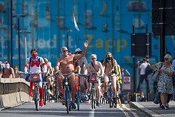© Licensed to London News Pictures.  14/08/2021. London, UK. Nude protesters take part in a naked bike ride in central London as part of the World Naked Bike Ride event, which protests against car culture and aims to raise awareness of cyclists on the roads. Photo credit: Marcin Nowak/LNP