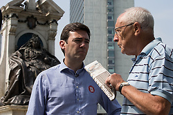 © Licensed to London News Pictures . 09/06/2016 . Manchester , UK . ANDY BURNHAM MP for Leigh and candidate for Labour's campaign for Greater Manchester Mayor , talking to a passer by as he campaigns for Britain to Remain in the EU in Piccadilly Gardens in Manchester City Centre . Photo credit : Joel Goodman/LNP