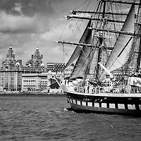 The Tall Ships Youth Trrust ship as it heads past the 3 Graces and out to sea.