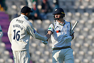 Gary Ballance of Yorkshire walks off at the end of play on day 1 unbeaten on 120 not out and is congratulated by Aiden Markram of Hampshire during the Specsavers County Champ Div 1 match between Hampshire County Cricket Club and Yorkshire County Cricket Club at the Ageas Bowl, Southampton, United Kingdom on 11 April 2019.