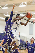 Cedar Ridge's Cameron Mark attempts a basketball against San Marcos Friday at home.  The Raiders beat the Rattlers 88-87 in overtime.  (LOURDES M SHOAF for Round Rock Leader.)