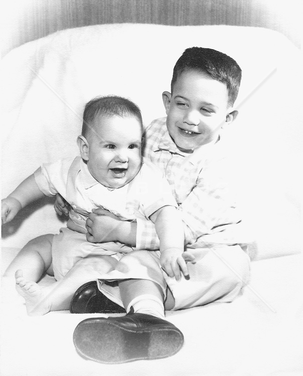 1960's photograph of a baby and his 2 year old brother