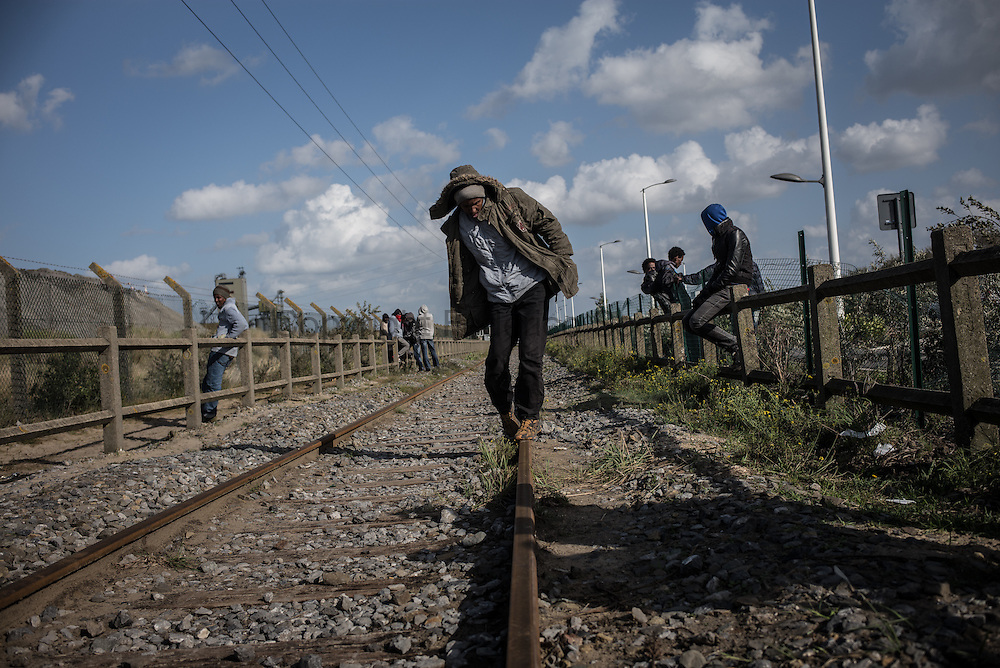 Migrants playing on a railroad waiting for spme truk