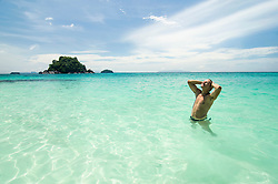 man standing in the ocean, Koh Lipe, Thailand