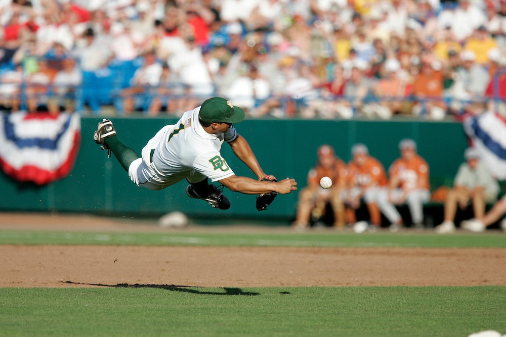 18 June 2005: Baylor 2B Michael Griffin is airborne while throwing the ball to first base in the top of the fourth inning during game 4 of the 2005 College World Series at Rosenblatt Stadium in Omaha, NE..