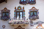 Traditional painted walls above jewellery and gift shop Tiroler Schmudkaftl in the town of Seefeld in the Tyrol, Austria