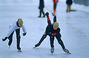 The legs and arms of young speed skaters merge during a race at a local track, on 11th January 1999, in Quebec City, Quebec, Canada.