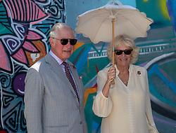 The Prince of Wales and Duchess of Cornwall stand in front of a mural of Kofi Annan, during a visit to the Jamestown Cafe in Accra, Ghana, on day four of their trip to west Africa.