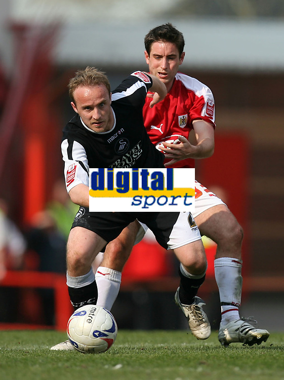 Photo: Rich Eaton.<br /> <br /> Bristol City v Swansea City. Coca Cola League 1. 07/04/2007. Thomas Butler left of Swansea and Bristols Lee Johnson go for the ball