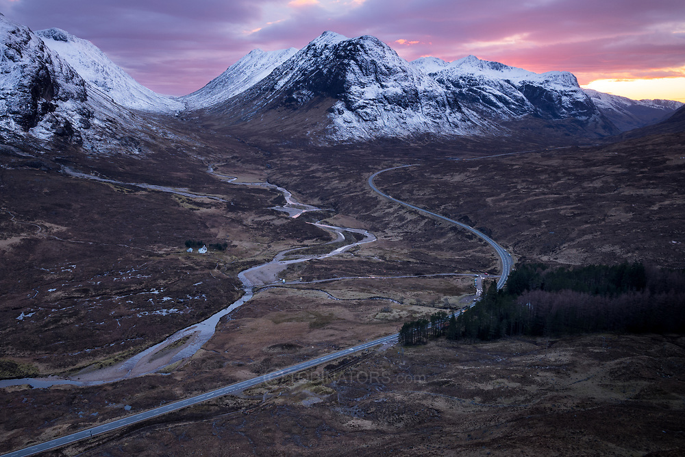 Glencoe and Buchaille Etive Mor (L) and Buchaille Etive Beag (R) from halfway up Beinn A' Chrulaiste, showing the A82 road, at sunset.
