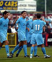 Photograph: Scott Heavey.<br />Stevenage Borough V Tottenham Hotspur. Pre-season friendly. 16/07/2003.<br />Milenko Acimovic celebrates opening the scoring for Spurs.