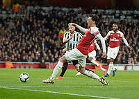 Football - 2018 / 2019 Premier League - Arsenal vs. Newcastle United<br /> <br /> Mesut Ozil (Arsenal FC) stretches to get his foot on the cross at The Emirates.<br /> <br /> COLORSPORT/DANIEL BEARHAM