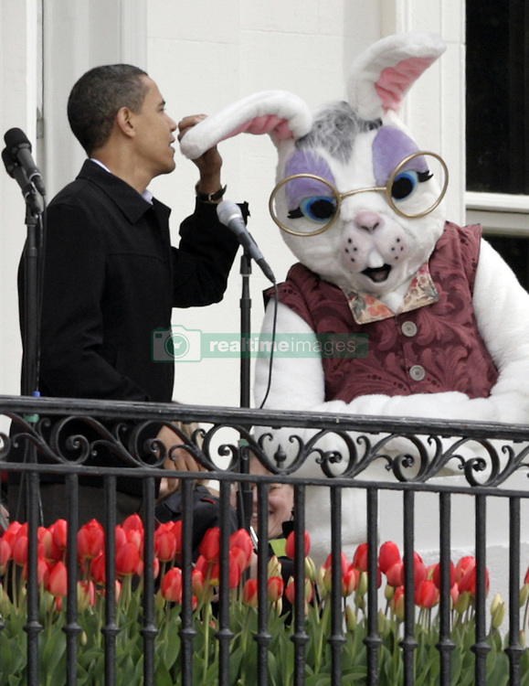 US President Barack Obama delivers a welcome speech prior to the Easter Egg roll at the White House in Washington, DC, USA on April 13, 2009. Photo by Yuri Gripas/ABACAPRESS.COM    184311_001 Washington