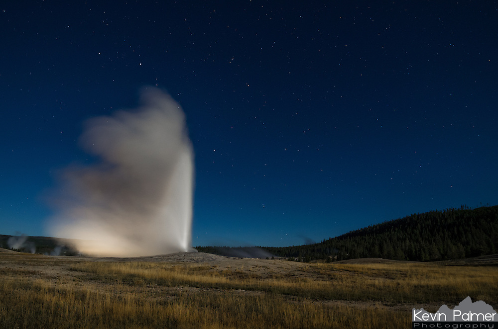 Old Faithful in Yellowstone National Park erupts under the light of a full moon. It is the most predictable geographical feature on Earth with eruptions about every 91 minutes. Even though it is one of the most popular sights in the park, there were very few people out to see it at 10pm.  Partially hidden behind the top of the plume, you can see the Big Dipper, or 'Ursa Major' constellation.