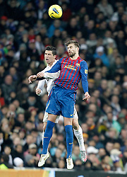10.12.2011, Santiago Bernabeu Stadion, Madrid, ESP, Primera Division, Real Madrid vs FC Barcelona, 15. Spieltag, im Bild Barcelona's Gerard Pique against Real Madrid's Cristiano Ronaldo // during the football match of spanish 'primera divison' league, 15th round, between Real Madrid and FC Barcelona at Santiago Bernabeu stadium, Madrid, Spain on 2011/12/10. EXPA Pictures © 2011, PhotoCredit: EXPA/ Alterphotos/ Alvaro Hernandez..***** ATTENTION - OUT OF ESP and SUI *****
