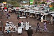 Vendors push trolleys at a market Narok, Kenya, after an afternoon rainstorm.