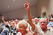 Aug, 25, 2009 -- SUN CITY, AZ: LIL SCHARENBRACH sits next to her husband ROGER SCHARENBRACH, who tried to ask a question of Sen. John McCain during the Town Hall meeting on health care sponsored by Sen McCain at Grace Bible Church in Sun City, AZ, Tuesday. More than 1,000 people attended the meeting in the church, which seats 700. Sun City is a staunchly Republican suburb of Phoenix and most of the crowd was opposed to President Obama health care reform efforts.    Photo by Jack Kurtz