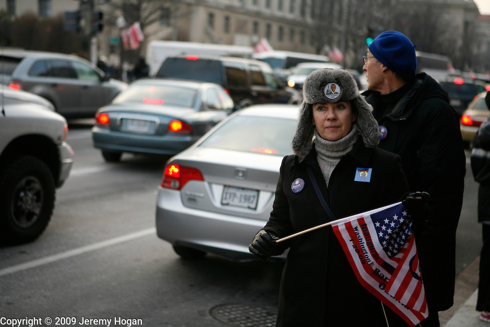 An Obama supporter waits for a taxi along Pennsylvania Aveenue on the eve of the Inauguration.