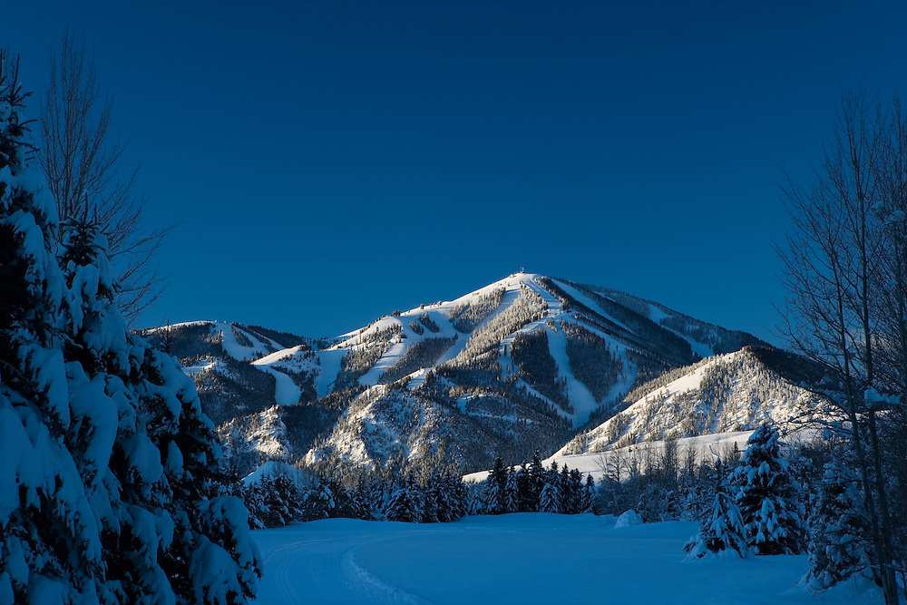 Sun Valleys Baldy Mountain catches the First Light on a Crystal Clear Winter's Morning.  Licensing and Open Edition Prints
