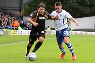Newport County's Danny Crow tries to get past Bury's Jordan Mustoe ® . Skybet Football League two match, Bury v Newport county at Gigg Lane in Bury on Saturday 5th Oct 2013. pic by David Richards, Andrew Orchard sports photography,