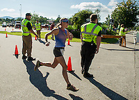 Kristina Folcik heads out onto the run portion of GLCAC's Marshmallow Man Triathlon Sunday morning from Opechee Park.  (Karen Bobotas/for the Laconia Daily Sun)