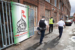 © Licensed to London News Pictures. 19/09/2018. London, UK. Police and a private security guard stand at the enter The Hussaini Association Islamic Centre in Cricklewood, north London where a car hit two pedestrians last night. The incident , which took place in the early hours of this morning outside the centre, is being treated as a possible hate crime. Police are looking for a male driver who failed to stop at the scene, as well as two men and one woman in the car, all in their 20s. Photo credit: Peter Macdiarmid/LNP