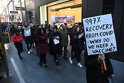 © Licensed to London News Pictures. 05/12/2020. London, UK. Protesters take part in an Anti Covid-19 lockdown demonstration in Stratford. The group  against the current tier regulations and anti-vaccination for the Covid-19 disease. Photo credit: London News Pictures