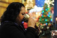 A parishioner takes Communion at Christ the King Church in Salinas during mass on the 4th Sunday of Advent.