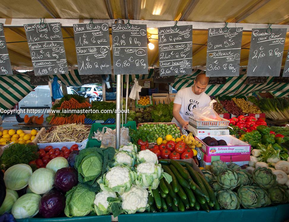 Vegetable stall at traditional market at Bastille in Paris France