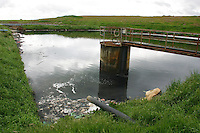 leachate pool on landfill site, with rubbish, chemical, organic and heavy metal contamination