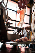 Mike Phillips of Red Table Meat Co. shaves paper-thin slices of cured meat with his nearly 100-year-old Berkl slicer at Food Building in Minneapolis, MN.