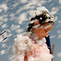 A refugee girl from one the northern cities of Israel during the Lebanon War at the refugee tent camp in the southern beach of Nitzanim, August 2006.