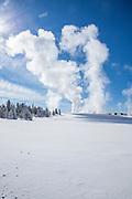 Fountain geyser erupting in the Lower Geyser Basin during winter