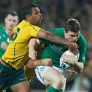 Brian O'Driscoll, Ireland, is tackled by Ben McCalman (below) and Kurtley Beale, during the Australia V Ireland Pool C match during the IRB Rugby World Cup tournament. Eden Park, Auckland, New Zealand, 17th September 2011. Photo Tim Clayton....