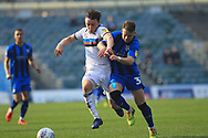 Ollie Rathbone is chased by Connor Ogilvie during the EFL Sky Bet League 1 match between Gillingham and Rochdale at the MEMS Priestfield Stadium, Gillingham, England on 30 March 2019.
