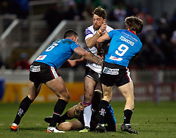 Wakefield Trinity's Danny Kirmond is tackled by Salford Red Devils' Luke Burgess (left) and Logan Tomkins during the Betfred Super League match at Belle Vue Stadium, Salford.