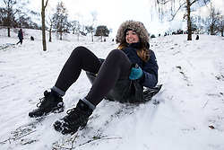 © Licensed to London News Pictures. 28/02/2018. London, UK. Sledging in Greenwich Park following heavy snowfall and sub zero temperatures overnight. The cold weather originating in Siberia has been dubbed 'the Beast from the East'.  Photo credit : Tom Nicholson/LNP