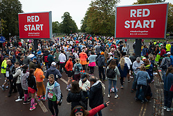 © Licensed to London News Pictures. 03/10/2021. London, UK. Runners arrive in Greenwich Park ahead of the start of the London Marathon.This London Marathon will be the first full scale staging of the race in more than two years due to the Coronavirus Pandemic.  Photo credit: George Cracknell Wright/LNP