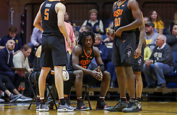 Jan 12, 2019; Morgantown, WV, USA; Oklahoma State Cowboys guard Isaac Likekele (13) sits on a chair during a timeout during the second half against the West Virginia Mountaineers at WVU Coliseum. Mandatory Credit: Ben Queen-USA TODAY Sports