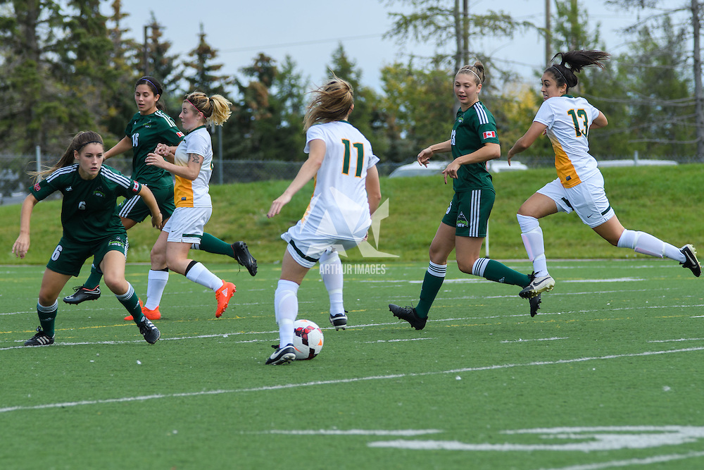 5th year midfielder Karlee Vorrieter (11) of the Regina Cougars sets up the attack during the Women's Soccer Homeopener on September 10 at U of R Field. Credit: Arthur Ward/Arthur Images