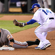 Kansas City Royals right fielder Norichika Aoki threw the ball to second baseman Omar Infante tagged out San Francisco Giants Brandon Belt during the fourth inning in Game 2 of the World Series on Wednesday, October 22, 2014 at Kauffman Stadium in Kansas City, Mo.