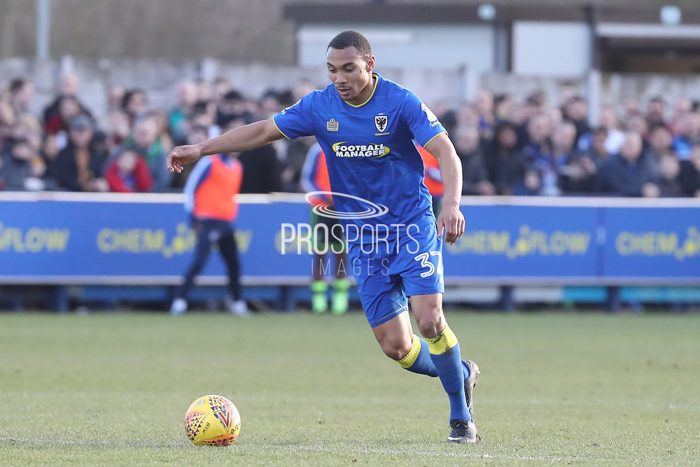 AFC Wimbledon defender Darius Charles (32) clearing the ball during the EFL Sky Bet League 1 match between AFC Wimbledon and Bristol Rovers at the Cherry Red Records Stadium, Kingston, England on 17 February 2018. Picture by Matthew Redman.