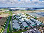 Nederland, Noord-Holland, gemeente Hollands Kroon, 07-05-2021; Wieringermeer, Middenmeer, Agriport A7. Microsoft mega-datacenter<br /> (Microsoft AMS05 en AMS06). De datacentra huisvesten de cloud diensten van Microsoft, Azure-cloudplatform.<br /> Wieringermeer, Middenmeer, Agriport A7. Microsoft mega data center. The data centers house the cloud services of Microsoft, Azure cloud platform<br /> <br /> luchtfoto (toeslag op standard tarieven);<br /> aerial photo (additional fee required)<br /> copyright © 2021 foto/photo Siebe Swart
